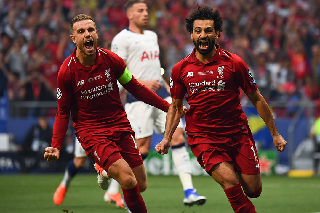 Liverpools Jordan Henderson och Mohamed Salah i Champions League-finalen 2019.